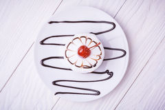 Cherry cupcake on white wooden table. top view Stock Image