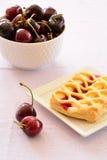 Cherry custard pastries Stock Images