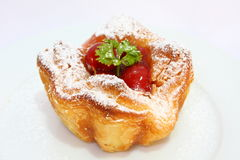 Cherry Danish Pastry. Delicious Danish pastry made with cherry and sauce Royalty Free Stock Photos