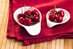Cherry on dark red napkin Royalty Free Stock Images