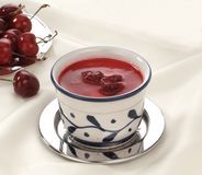 Cherry dessert. In the cup with cherry in the dish Stock Images