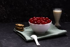 Cherry dessert served with cookies and milk. stock photos