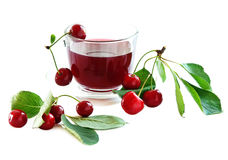 Cherry drink . Cherry drink in a glass mug and ripe cherries. isolated on a white background royalty free stock photography