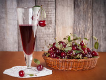 Cherry drink in the glass Royalty Free Stock Photos
