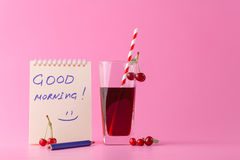 Cherry drink with ripe cherry berries and message good morning Royalty Free Stock Image