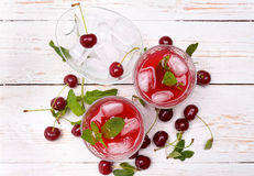 Cherry drink. Cherry drink on a white wooden table Stock Images