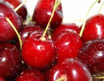 Cherry with drop. Group of cherry with drop in the basket royalty free stock images