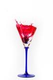 Cherry drop into red wine with splash Stock Photo