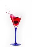 Cherry drop into red wine with splash Stock Photos