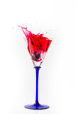 Cherry drop into red wine with splash Stock Images