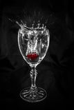 Cherry Dropping in wine glass Stock Photography