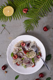 Cherry dumplings, made with wonton wrappers and cherries. Traditional cuisine recipe, Top view. Stock Images