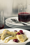 Cherry dumplings with sour cherry Royalty Free Stock Images