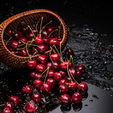 Cherry falling from basket Stock Photography