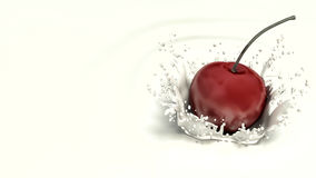 Cherry falling in milk Stock Photography