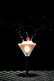 Cherry flying into a glass Stock Image
