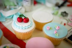 Cherry fondant cupcakes. Cherry fondant cupcakes and rose fondant cupcakes stock images