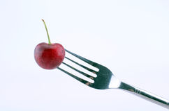 A cherry on a fork. Stock Photo