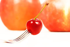 Cherry. On fork Royalty Free Stock Photography