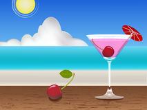 Cherry. Fresh juice on the table and beach Royalty Free Stock Image