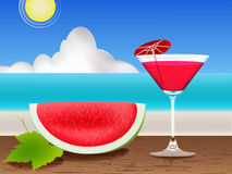 Watermelon. Fresh juice on the table and beach Royalty Free Stock Photo