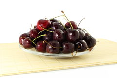 Cherry fruit with waterdrops in pure white background Stock Images