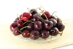 Cherry fruit with waterdrops in pure white background Stock Image