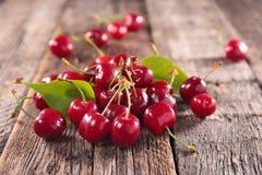Cherry fruit. On wood background stock image