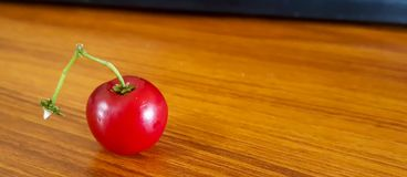 Cherry fruit on wooden desk royalty free stock photography