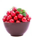 Cherry fruits in brown bowl Royalty Free Stock Image