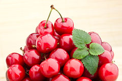 Cherry fruits in brown bowl Stock Photo