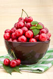 Cherry fruits in brown bowl Stock Photography