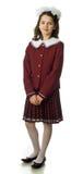 The cherry girl in a school uniform. The cherry girl in a school  uniform Royalty Free Stock Photography