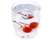 Cherry in glass Stock Photography