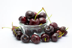 Cherry on a glass blow, white background Royalty Free Stock Photography