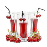 Cherry and glass of juice Stock Photo