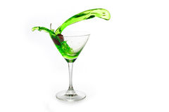 Cherry in glass. Red cherry in a glass of green drink Stock Photos