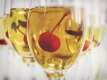 Cherry in glass of vine Royalty Free Stock Images