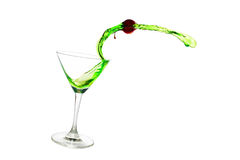Cherry and green. A cherry and water splashing out of glass Royalty Free Stock Image