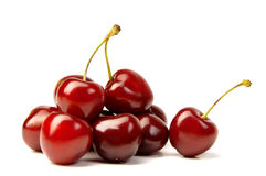 Cherry handful. Handful of a red cherry on a white background Stock Photos