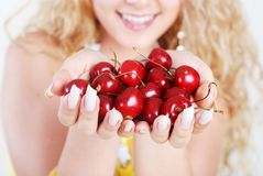 Cherry in hands Stock Images
