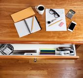 Cherry hardwood desk with personal income form and office suppli Stock Photos