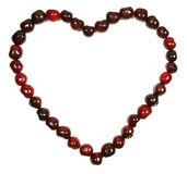 Cherry heart. Light and dark red cherries forming a heart stock photos