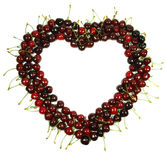 Cherry heart. Light and dark red cherries forming a heart royalty free stock photos