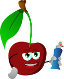 Cherry holding toothpaste Royalty Free Stock Photography