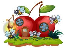 Cherry house and many bees flying Royalty Free Stock Photography