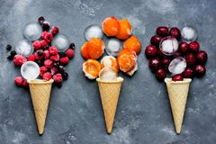 Cherry ice cream, berry ice cream, apricot ice cream - food art. From ice, waffle cones, fruit and berries royalty free stock photo