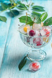 Cherry in ice cube in glass bowl Royalty Free Stock Photos