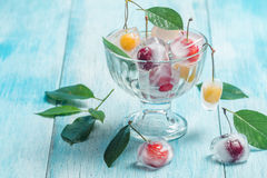 Cherry in ice cube in glass bowl Stock Images
