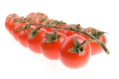 Cherry isolerad tomat Arkivfoto